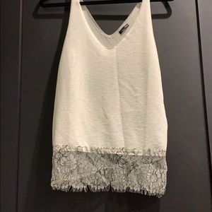 White top with black and white lace trim